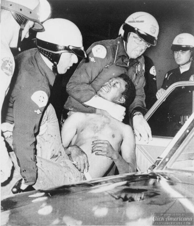 Police arrest a man during the Watts Riots 8121965