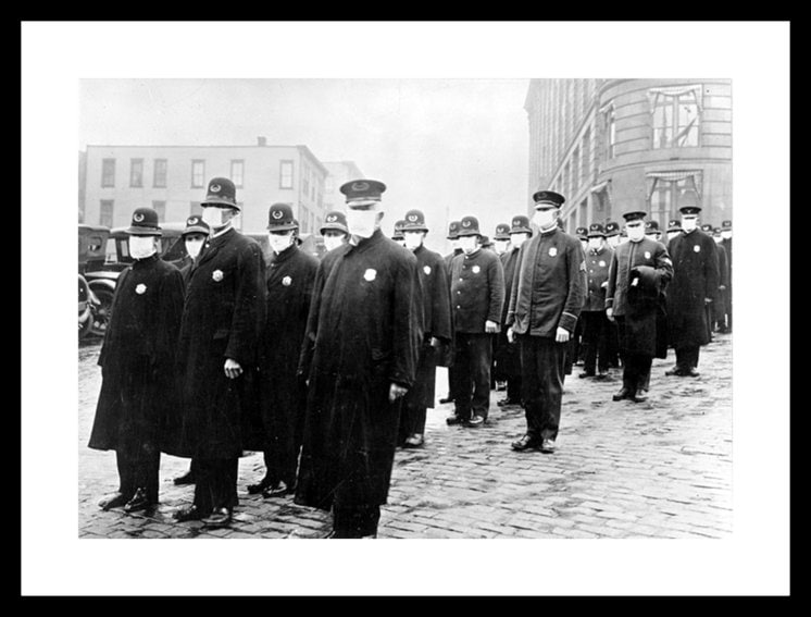 Policemen in Seattle wearing masks made by the Red Cross, during the influenza epidemic. December 1918