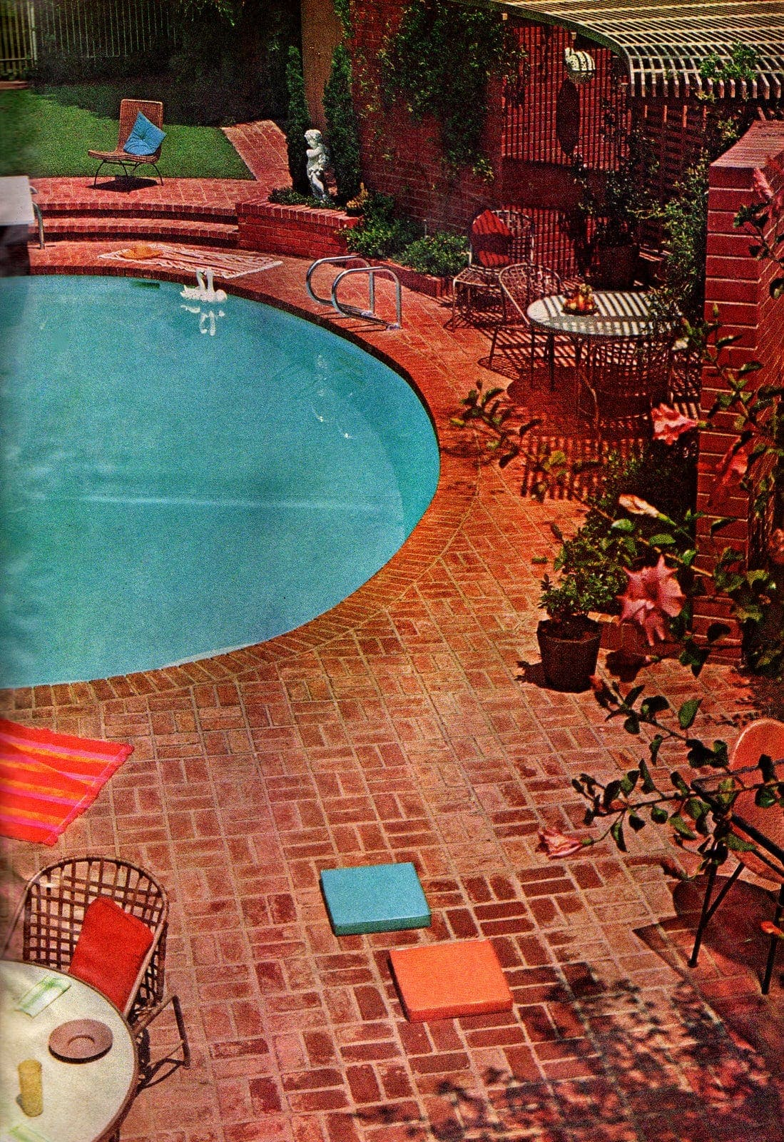 Pretty brick patio deck around a circular pool in the backyard - Vintage landscaping from 1966
