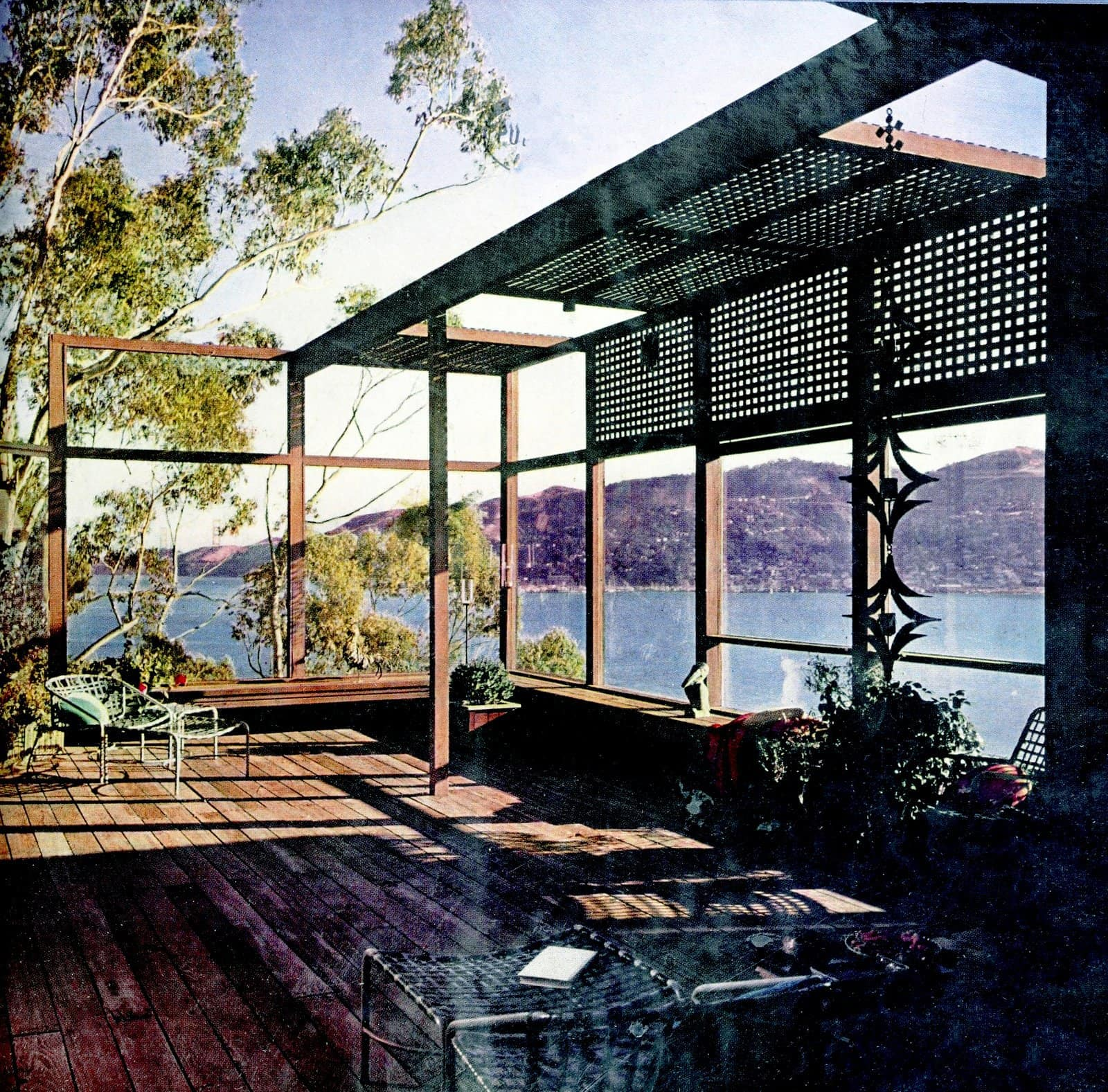 Redwood deck with trellis and windows to a beautiful water view (1962)