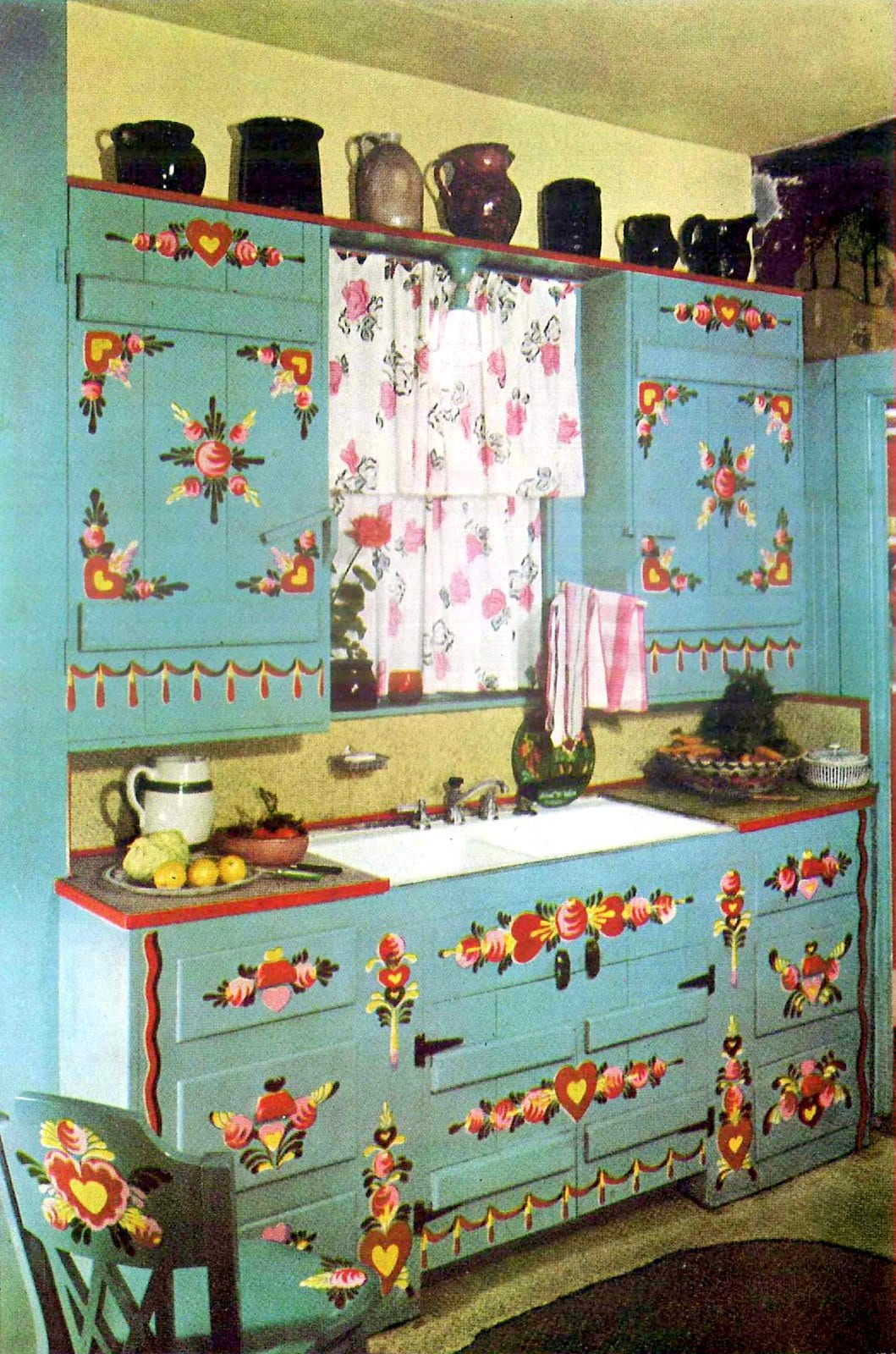 Restored kitchen cabinetry with retro Pennsylvania Dutch folk-art style paintwork by Peter Hunt