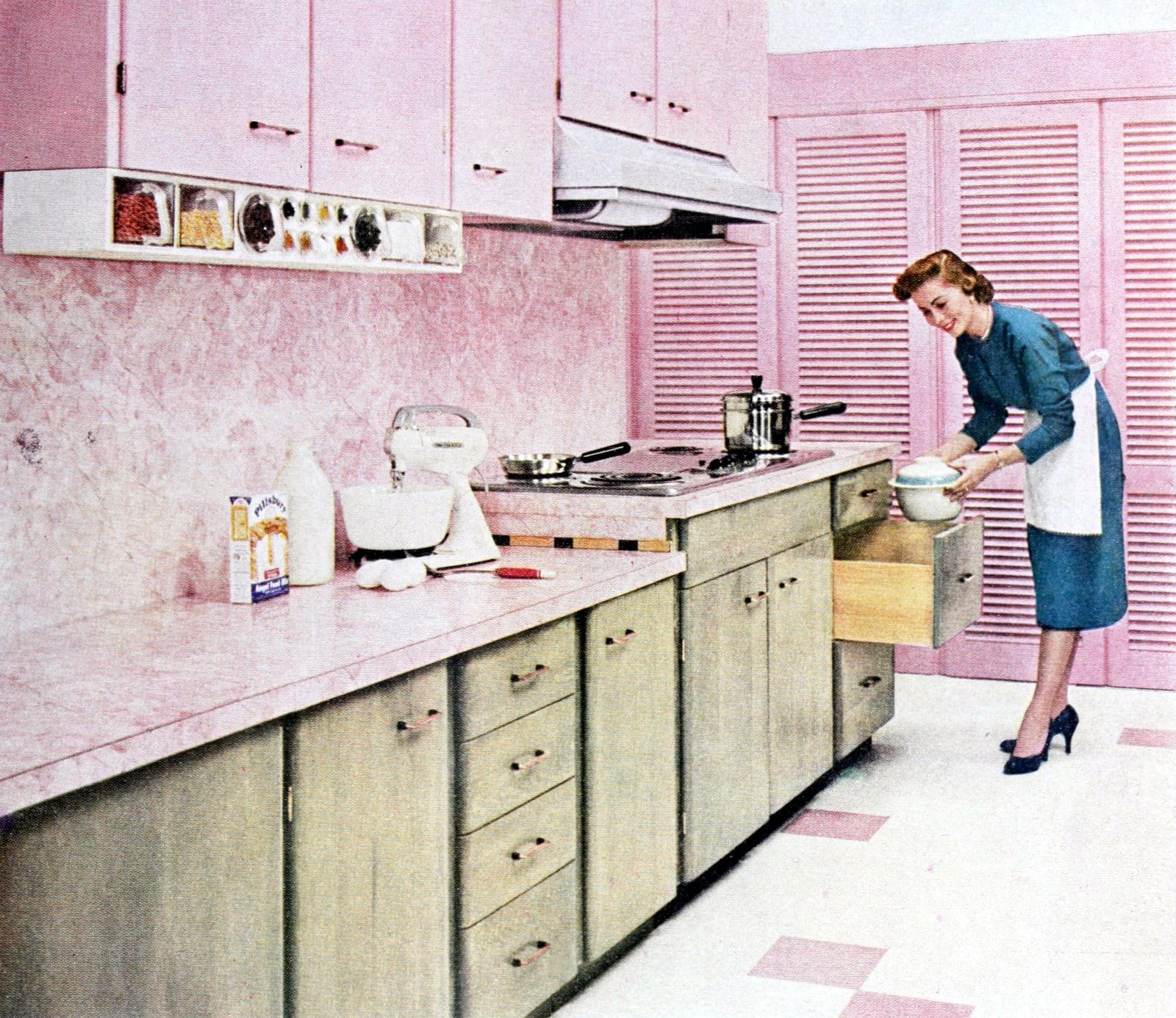 Retro 1950s pink and white kitchen with wood lower cabinets (1956)
