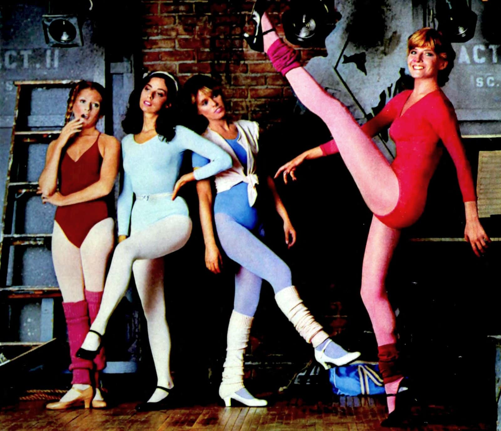 Retro 1980s dancers in tap shoes, leotards and leg warmers