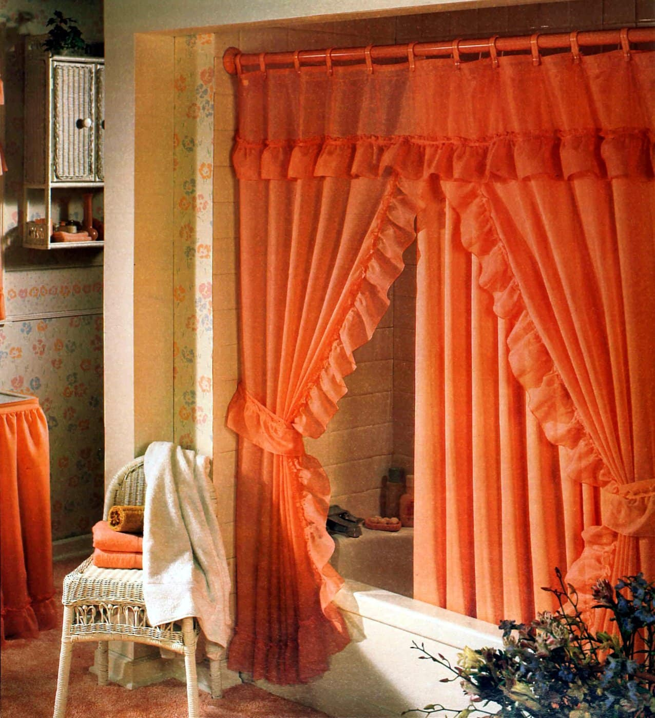 Retro 1980s orange bathroom decor and frilly curtains
