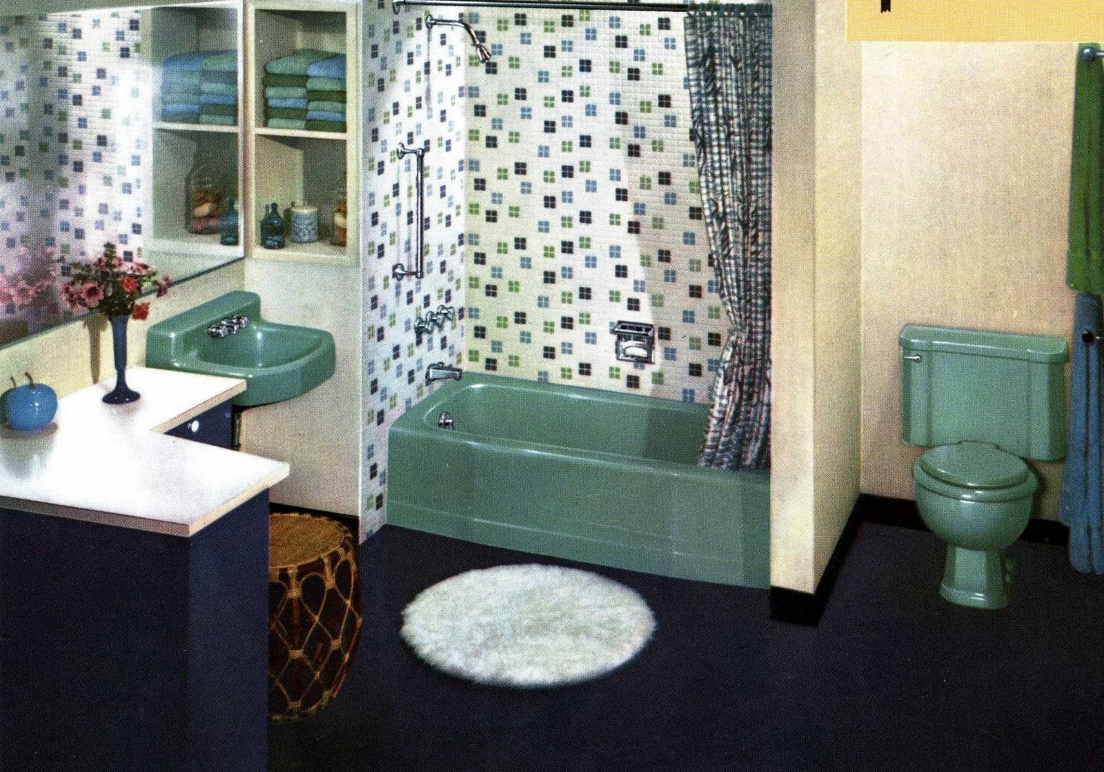 Retro fifties bathroom decor in jade green and navy blue with white accents