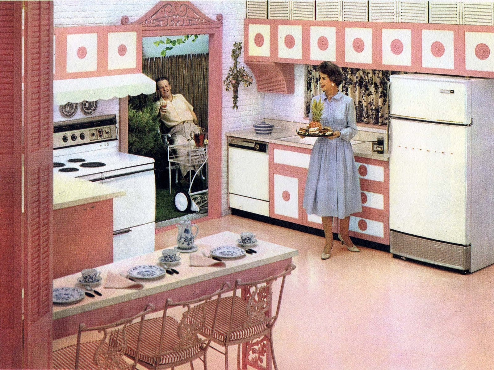 Retro kitchen with pink and white dotted cabinets