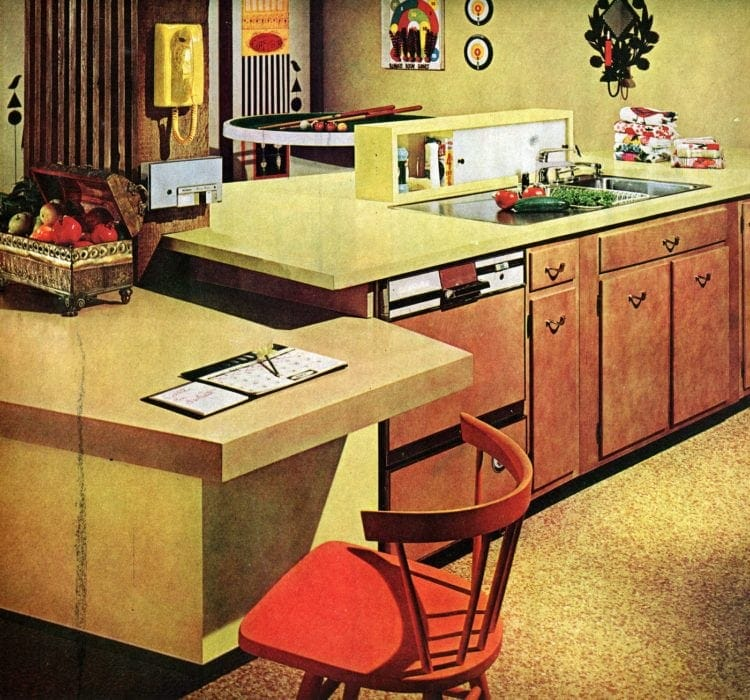 Retro multi-level kitchen peninsula with desk and eating area from 1965