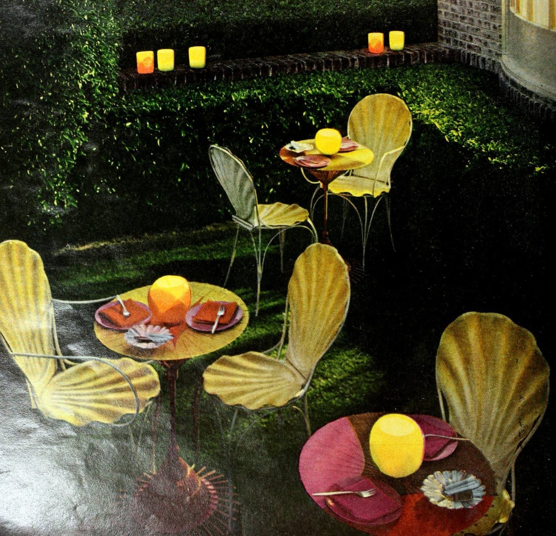 Retro scallop-shaped metal indoor-outdoor informal chairs (1963)