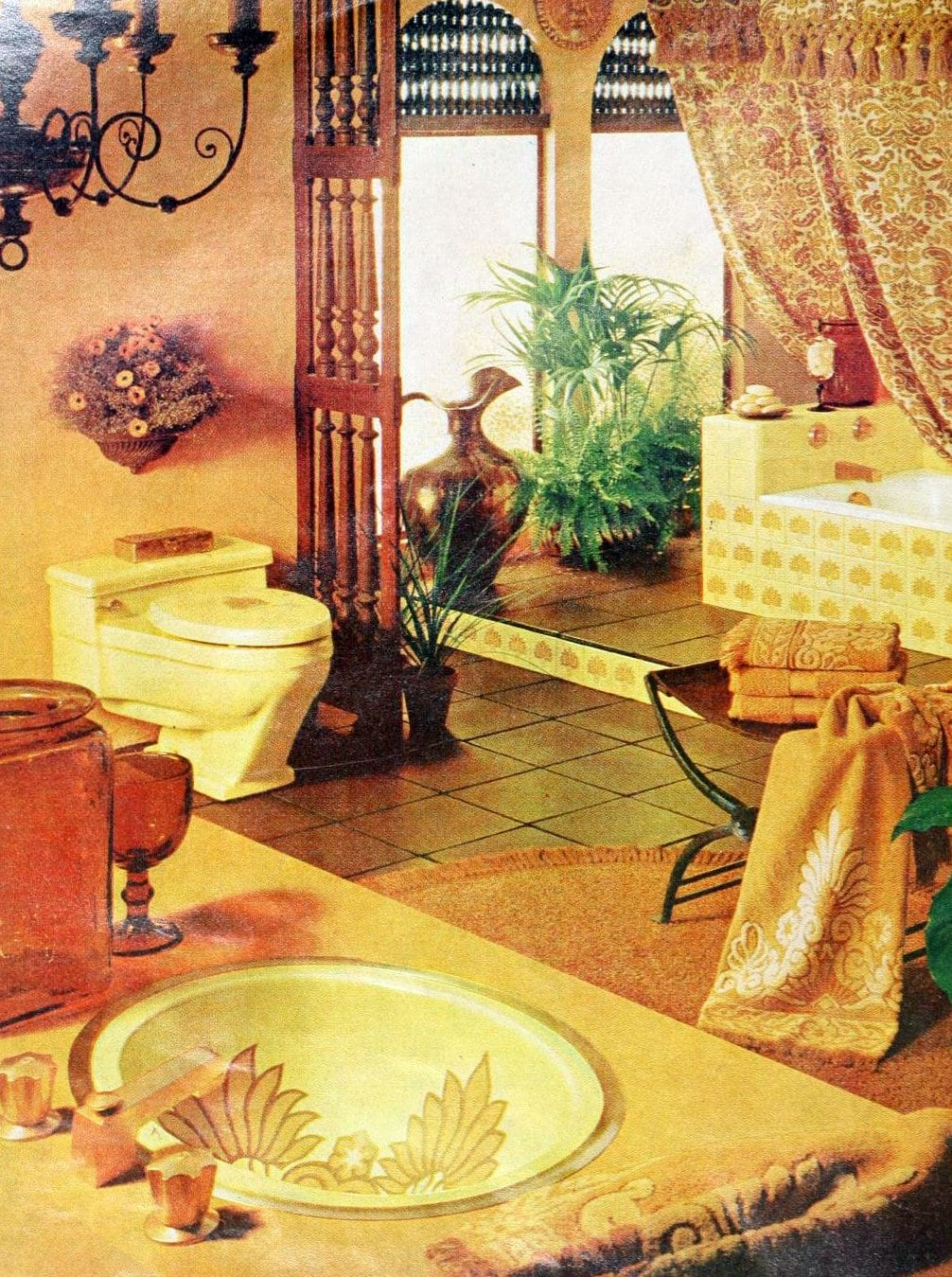 Retro yellow bathroom decor with patterned tile and sink from the 60s