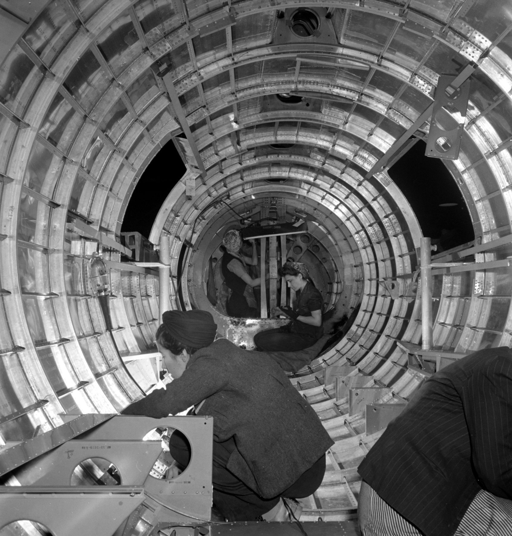 Riveters working on a B-17