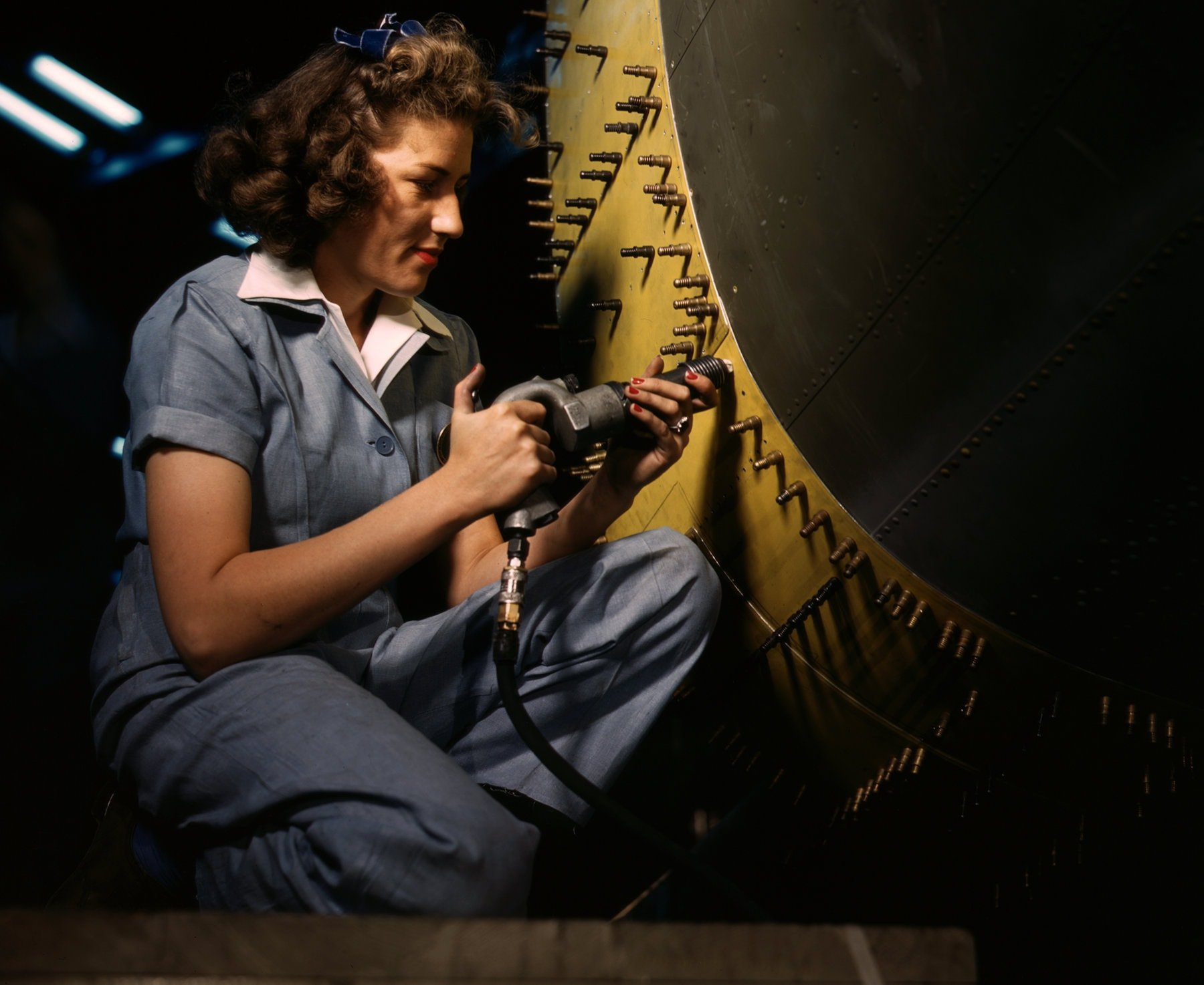 Riveting a Consolidated bomber plane