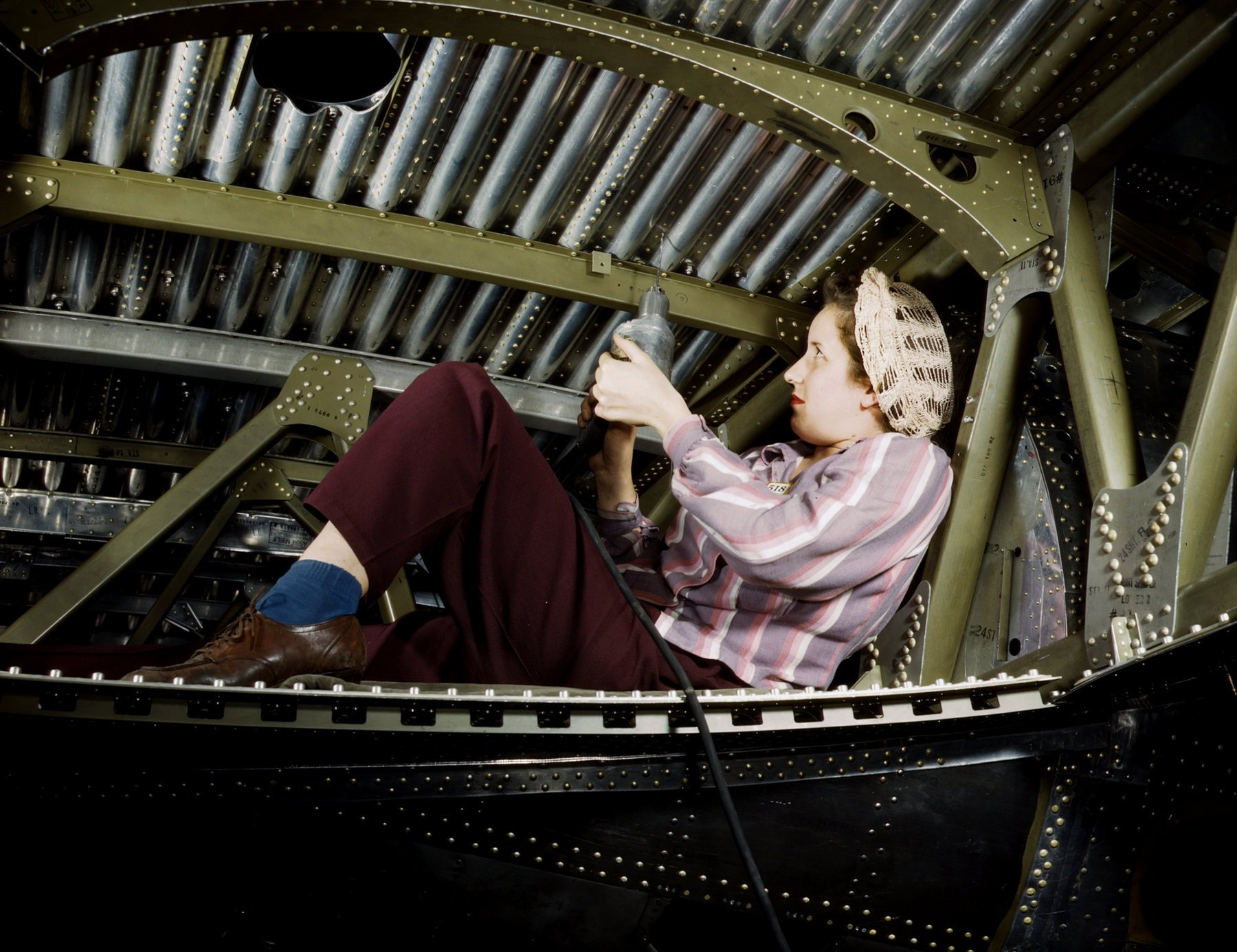 Riveting a A-20 bomber