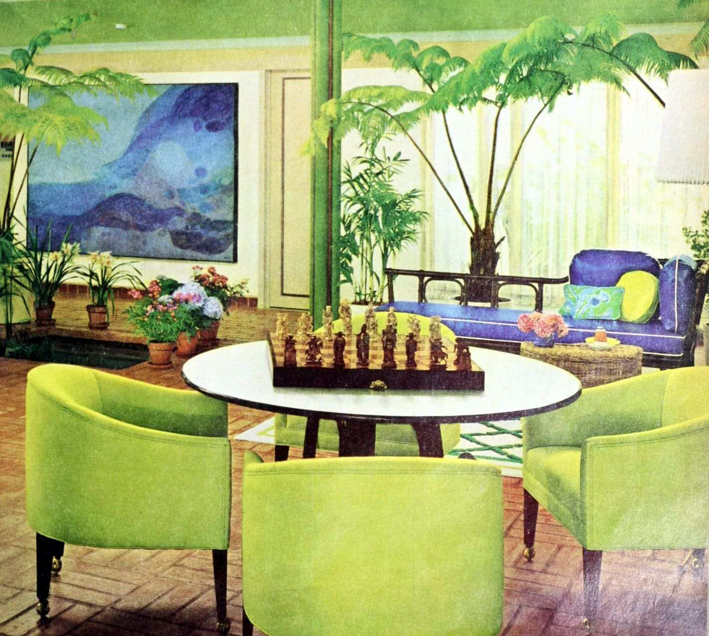 Round green barrel-style chairs at a game table - Retro sixties home decor
