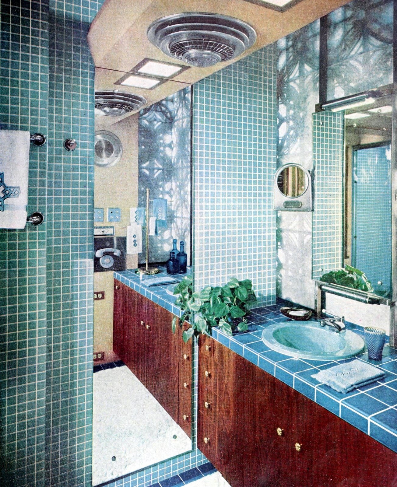 Shades of blue tile in this retro 60s bathroom