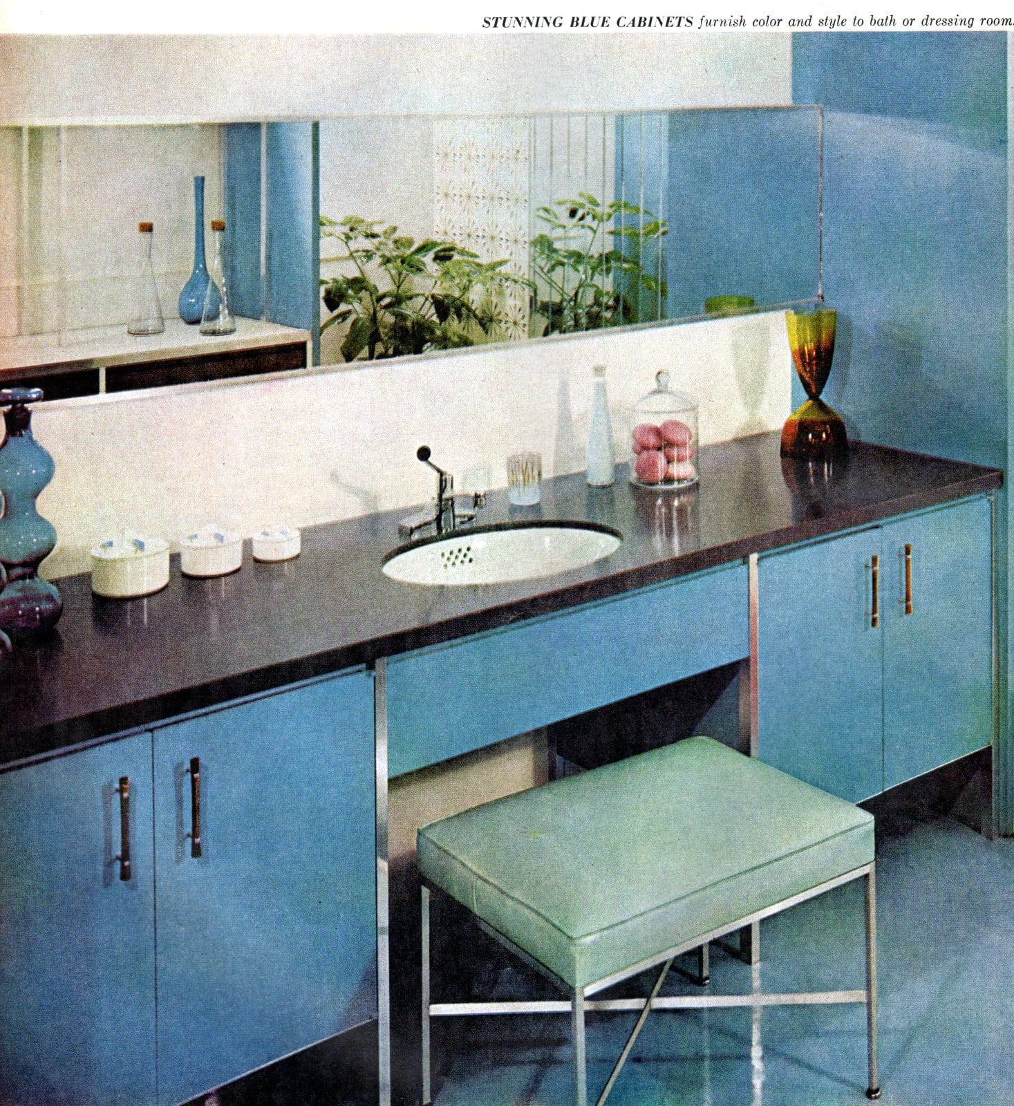 Sleek stylish mid-century modern style blue bathroom