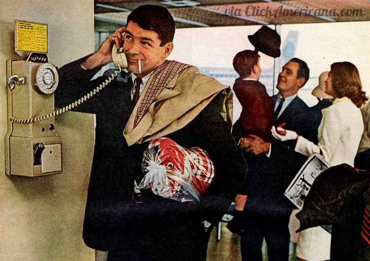 A smoking man at the airport with a payphone on the wall (1964)