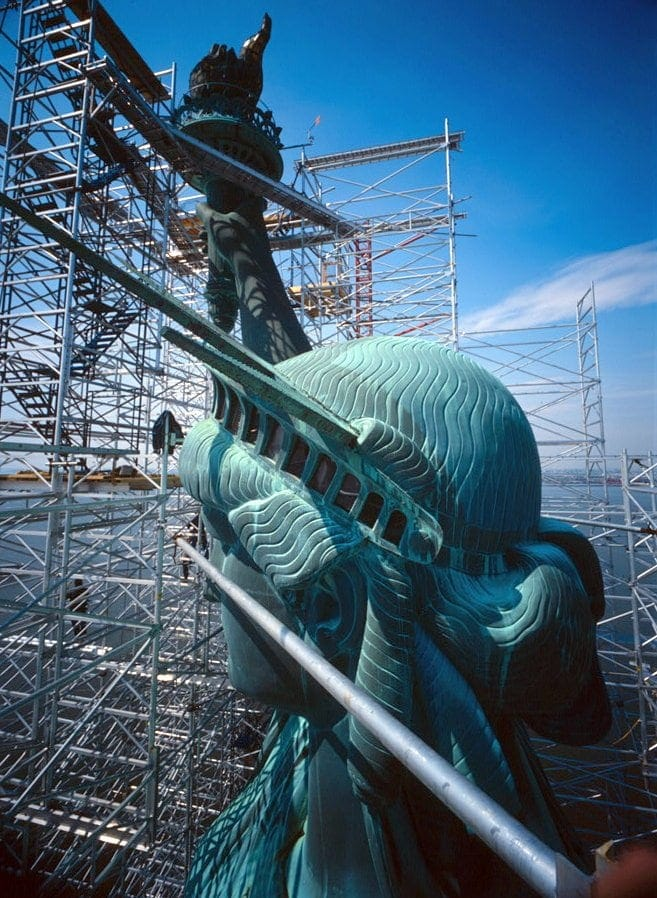 Statue of Liberty with scaffording during repairs in the eighties
