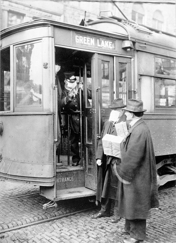 Street car conductor in Seattle not allowing passengers aboard without a mask. 1918