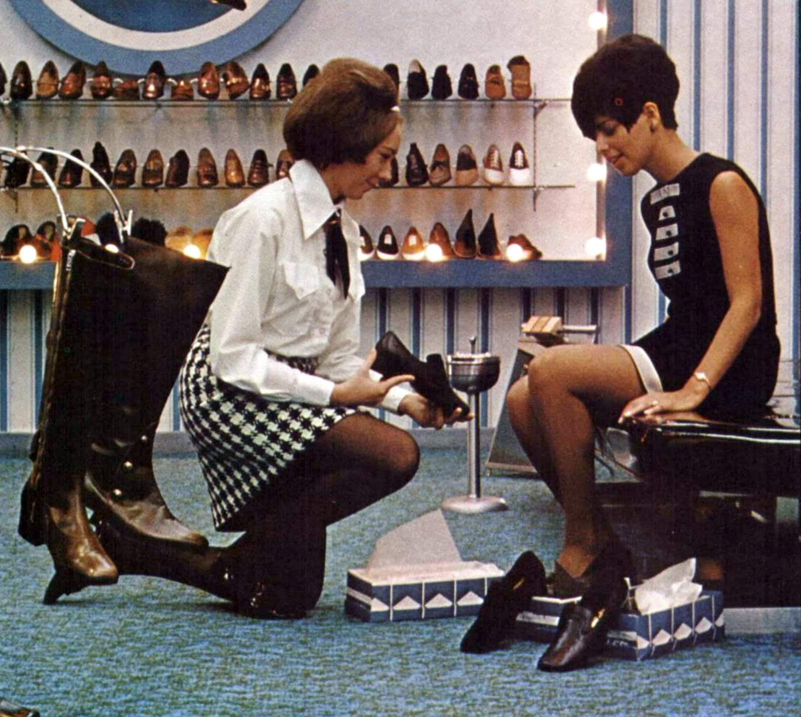 Stylish sixties woman trying on shoes (1968)