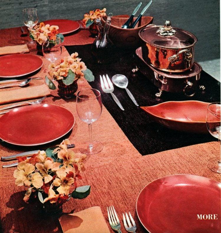 Table setting in peach and orange tones 1958