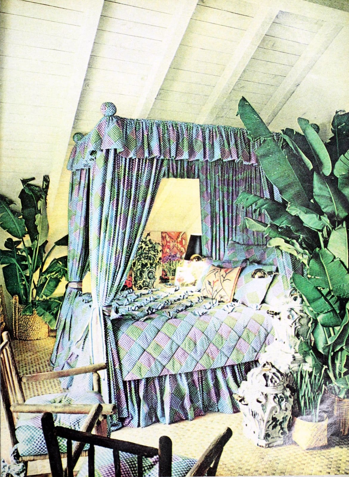 Tall canopy bed in blue in a room with a high sloped ceiling (1973)