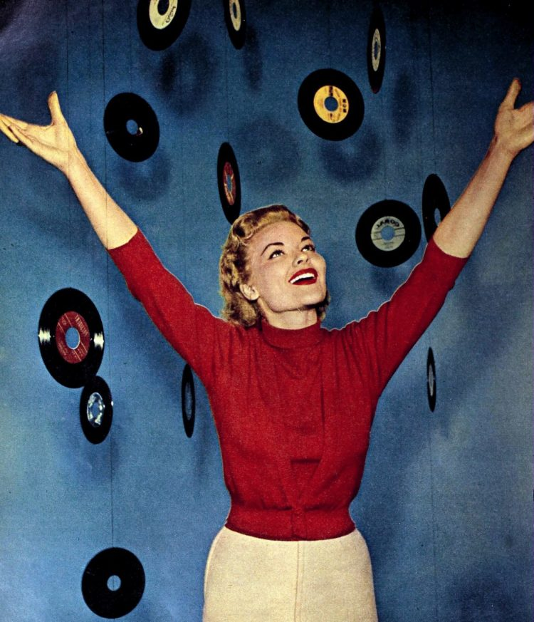 50s teen girl with old 45 RPM singles records music