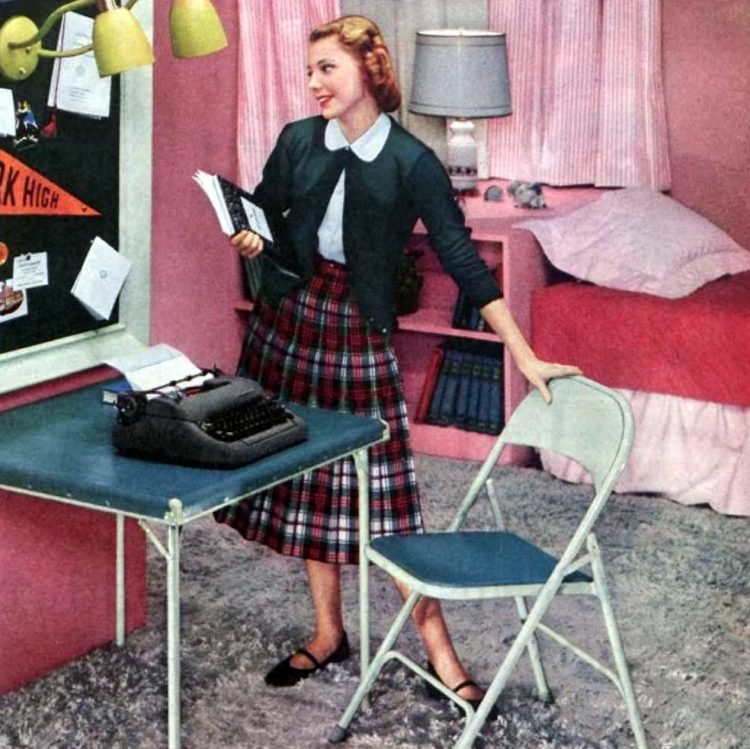 Teen girl in her bedroom getting ready for school in 1953