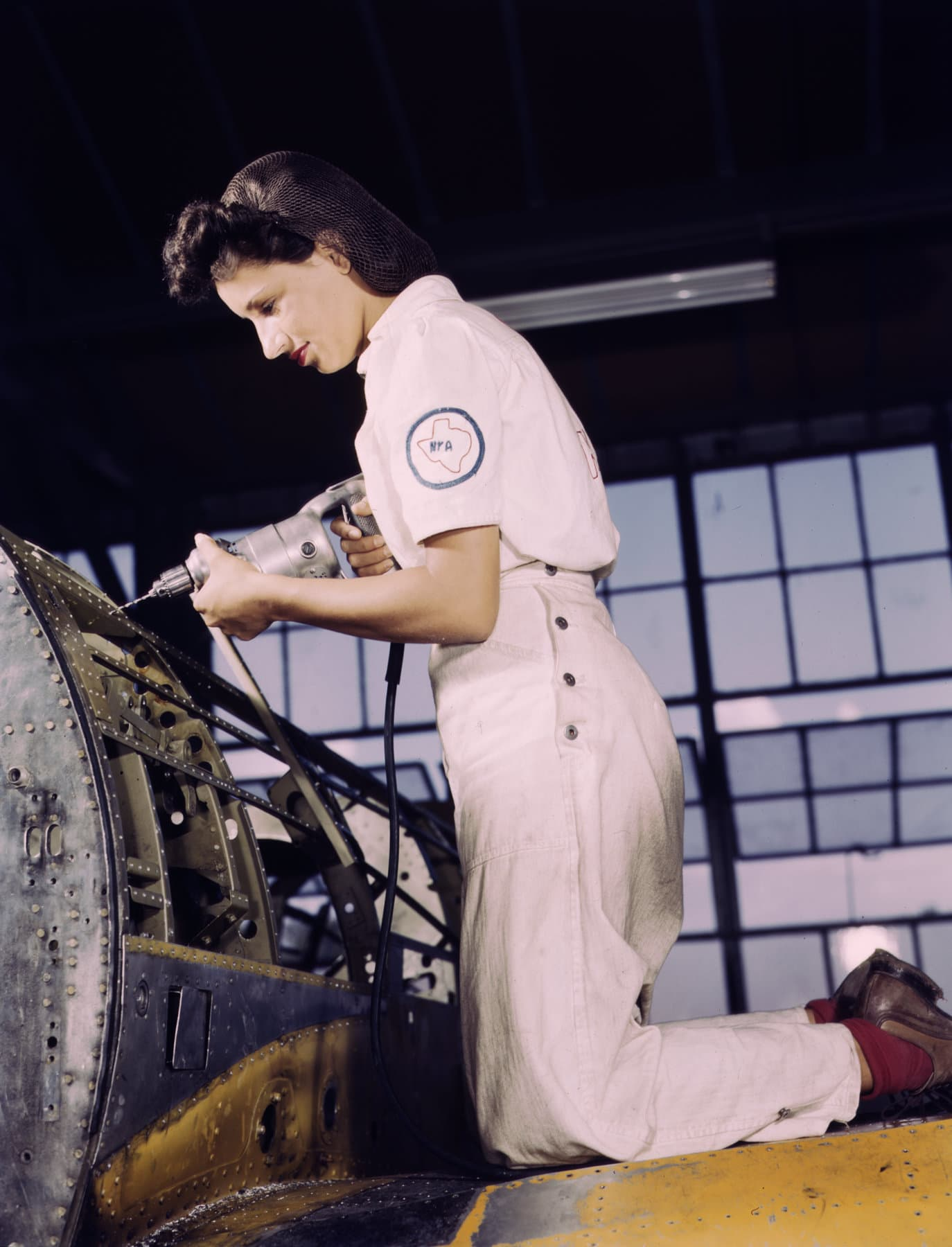 Texas woman learning to rivet for the 1940s war effort