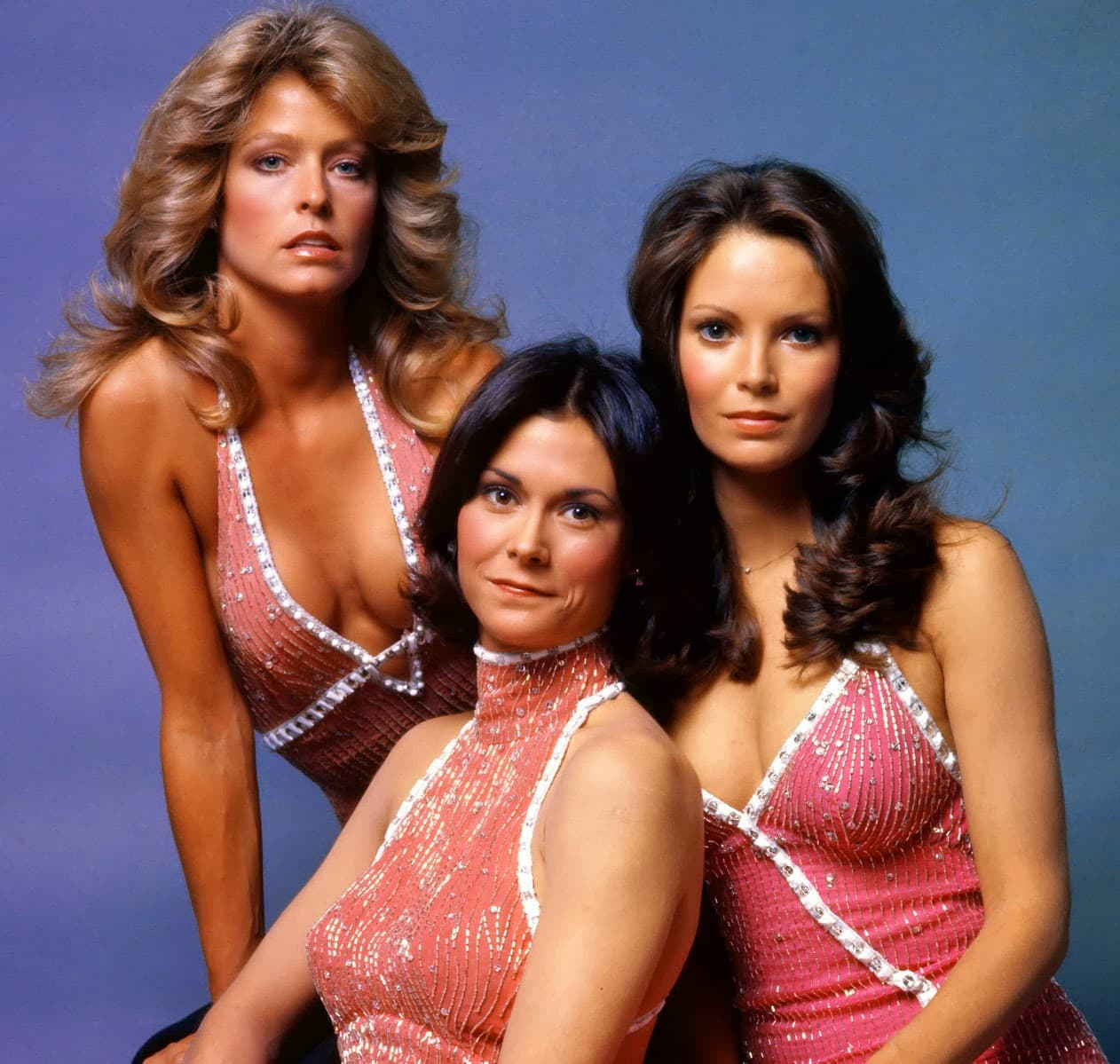 The original three Charlie's Angels actresses in pink evening gowns (1977)