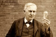 Thomas Alva Edison holding an incandescent lightbulb c1911