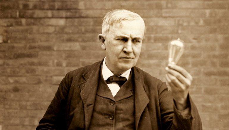 Thomas Alva Edison holding an incandescent lightbulb c1911