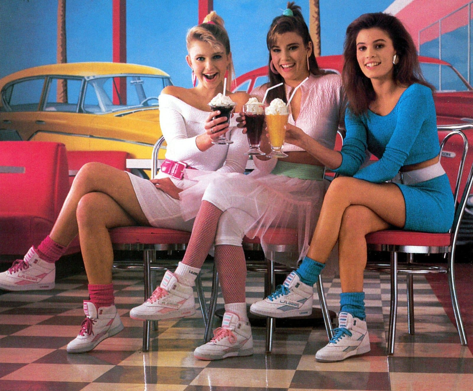 Three 80s girls with colorful socks in a faux soda shop