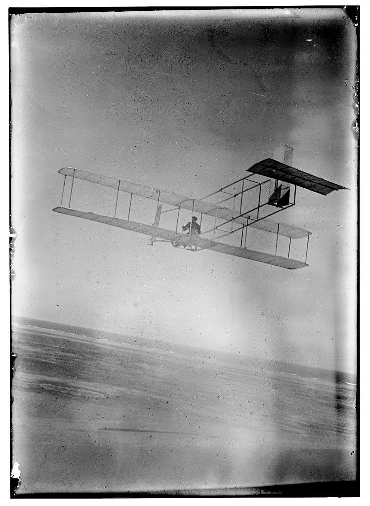 Three-quarter left rear view of glider in flight at Kitty Hawk, North Carolina