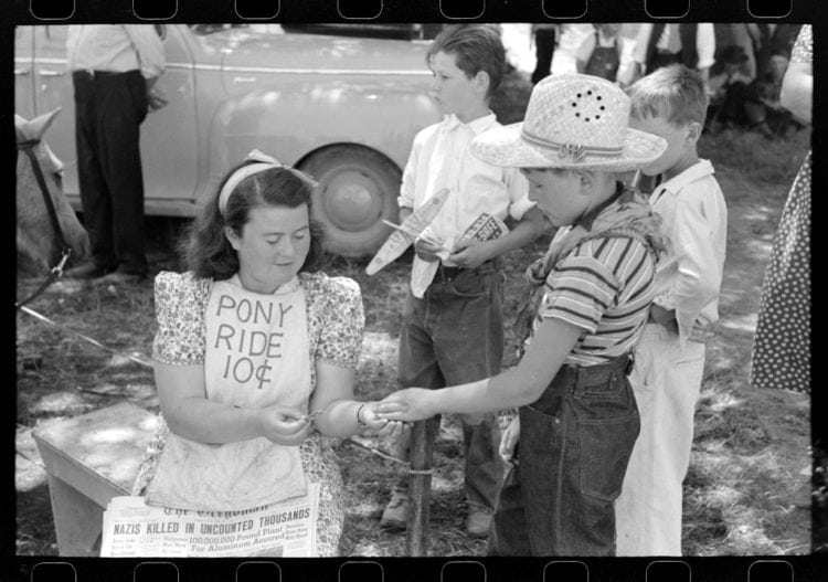 Ticket taker for pony ride concession on the 4th of July 1941 Vale, Oregon