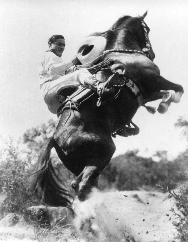 Tom Mix doing a stunt with his horse Tony