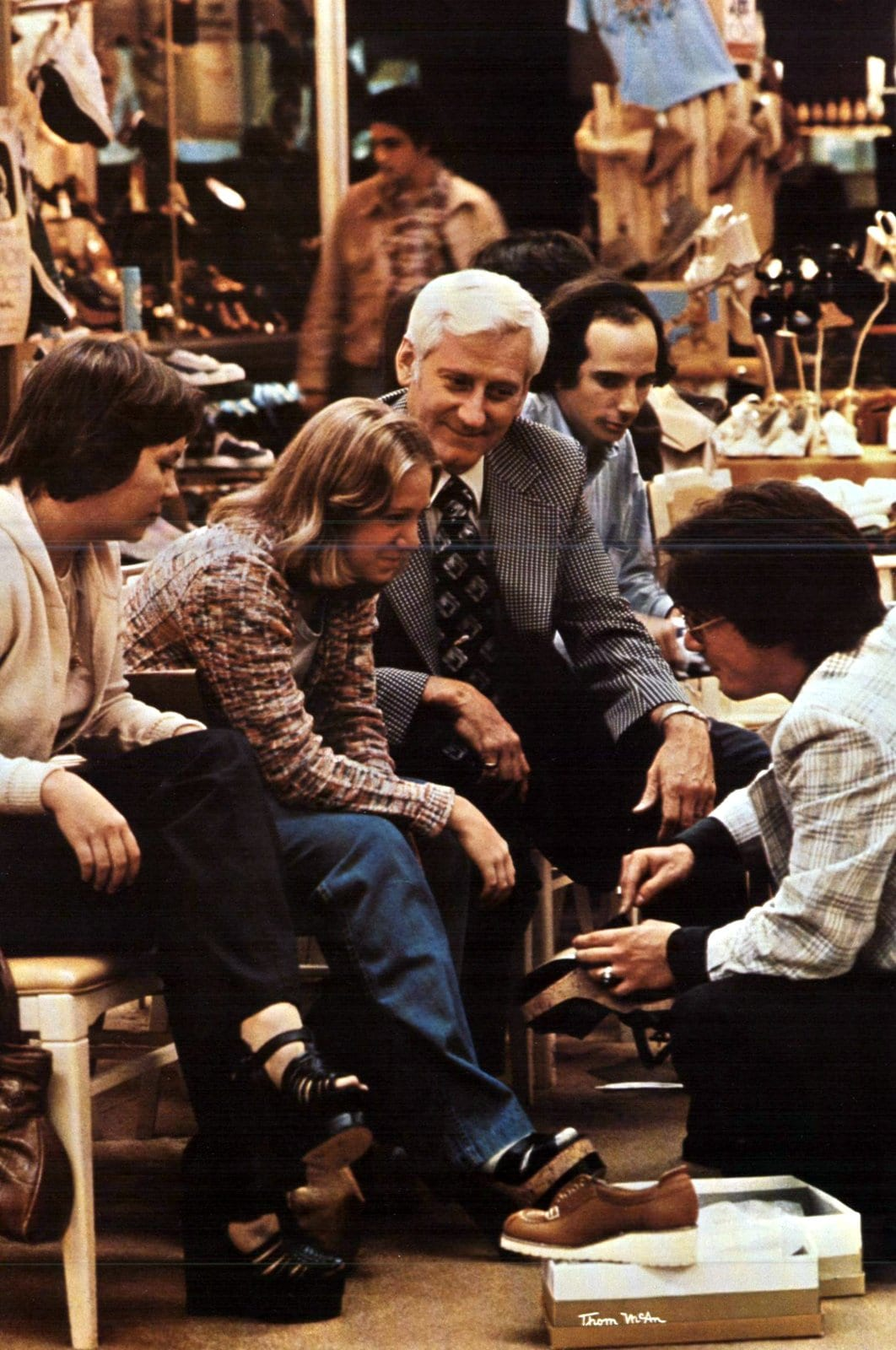 Trying on shoes at a vintage Thom McAn shoe store (1975)
