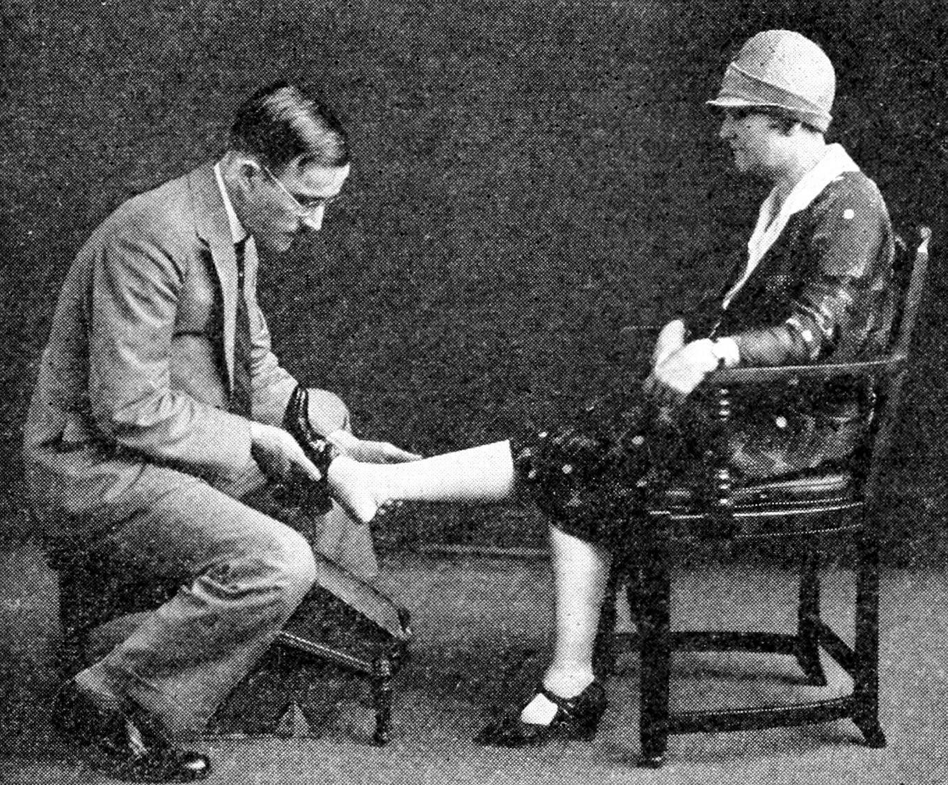 Trying on shoes in the 1920s