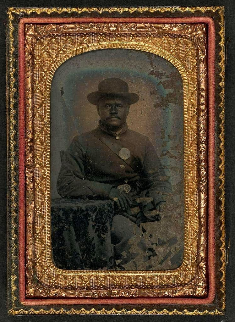 Unidentified African American soldier seated, in Union uniform
