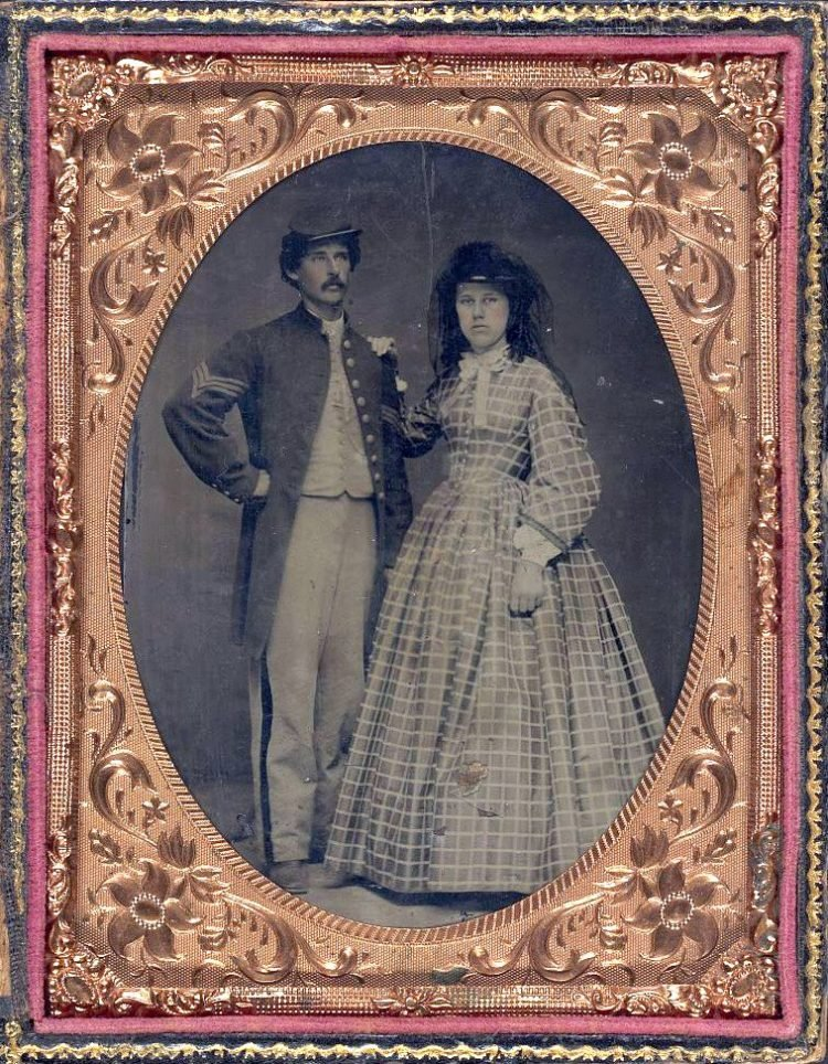 Unidentified soldier in Union sergeant's frock coat and forage cap with unidentified woman in dress and hat with veil
