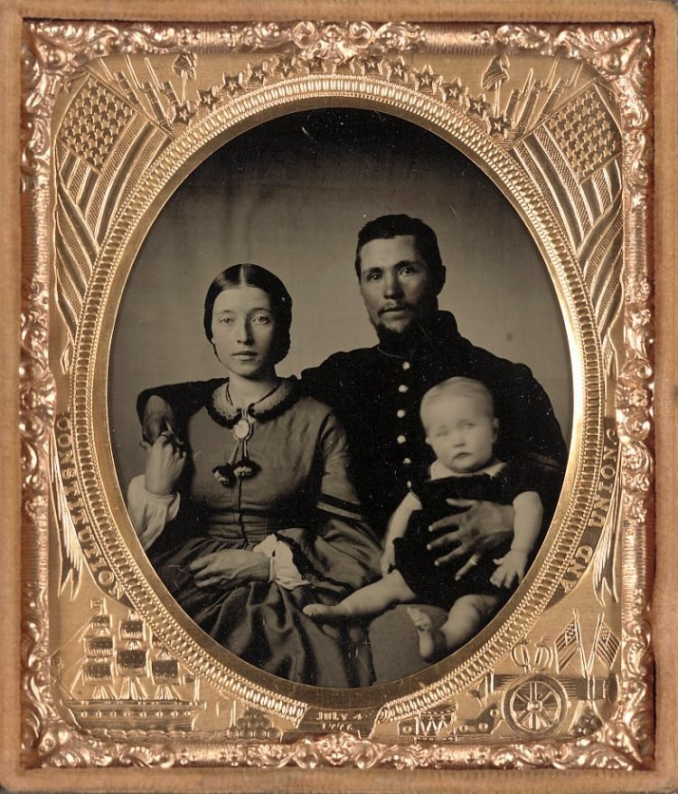 Unidentified soldier in Union uniform, woman and baby c1863