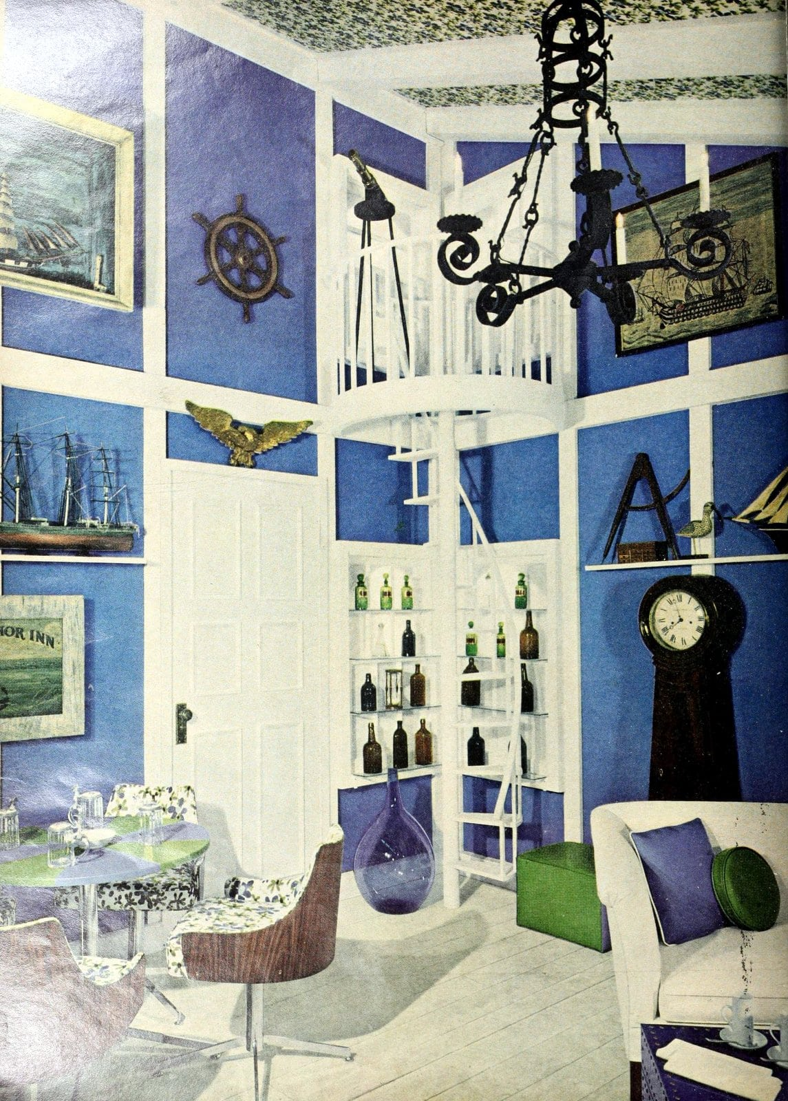 Unique blue and white wall treatment with lots of artwork and modern furniture (1963)
