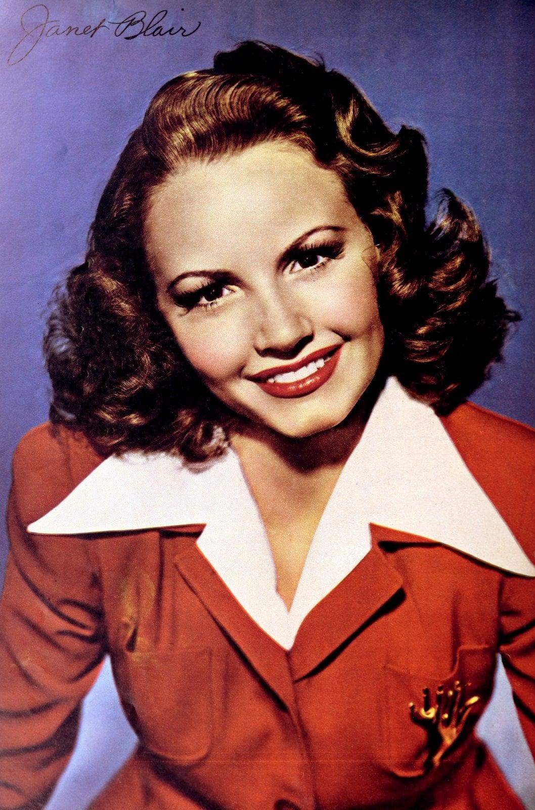Vintage 1940s actress Janet Blair wearing red lipstick
