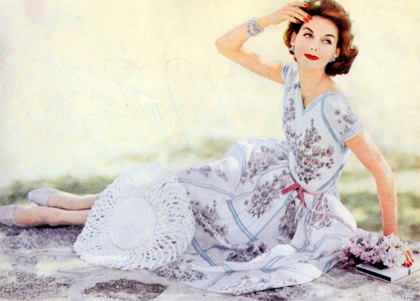 Vintage 1950s woman in a dress on the ground