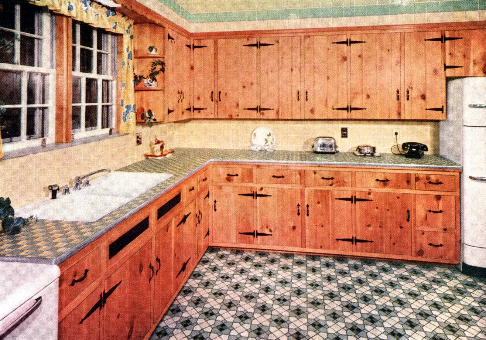 Vintage 1953 kitchen decor with tile patterns and knotty pine cabinetry