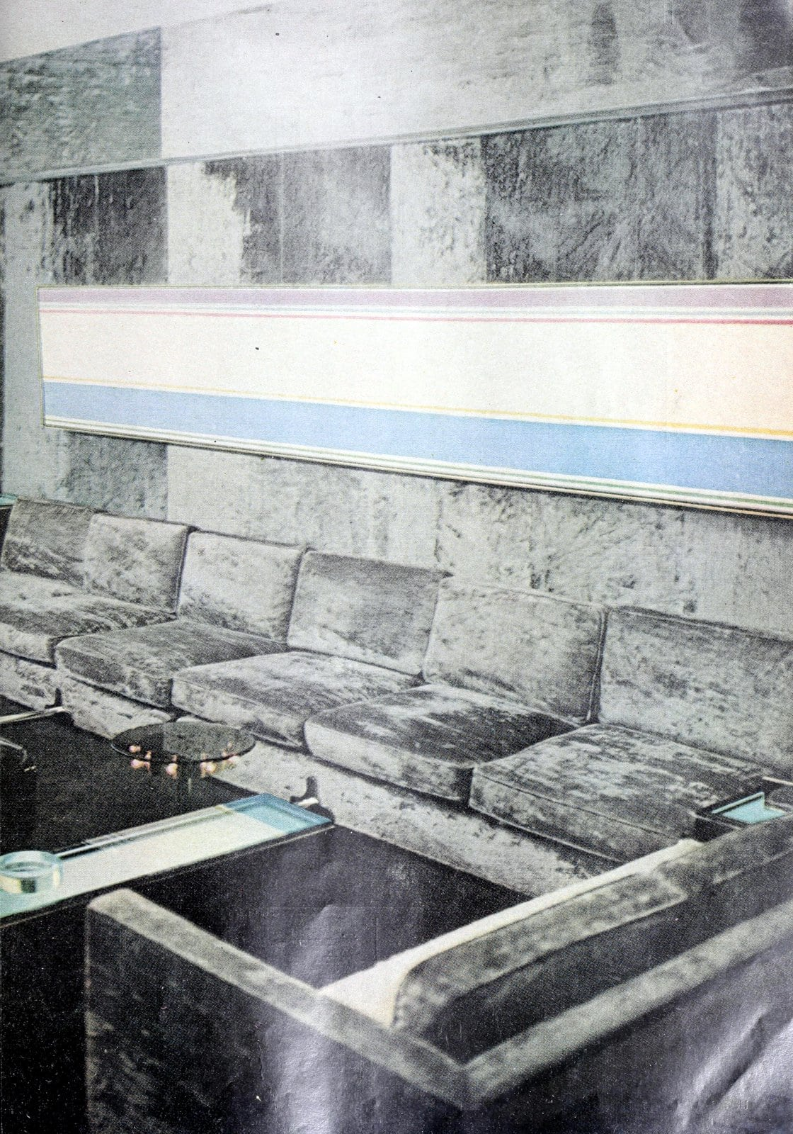 Vintage 1960s living room decor in shades of gray with a velvet sofa (1968)