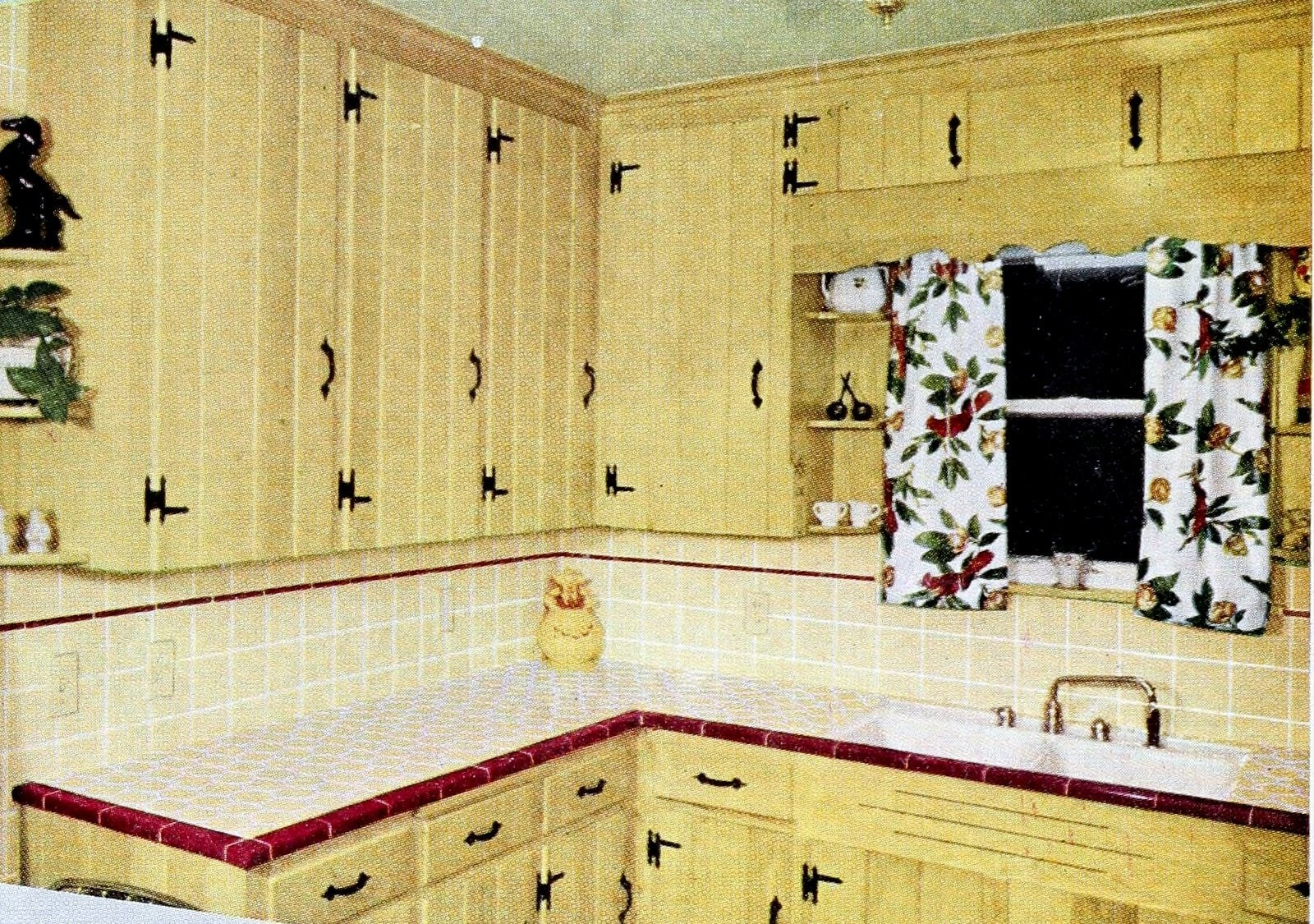 Vintage 50s kitchen with plank cabinetry and ceramic tile countertops (1954)