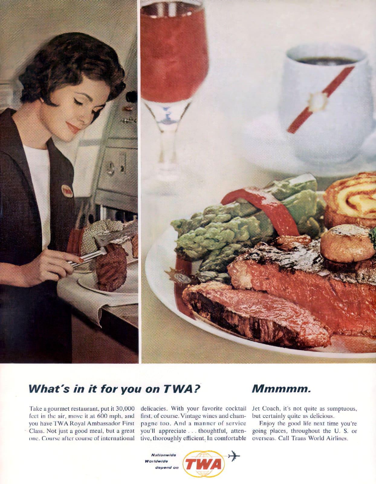 Vintage 60s TWA airlines stewardess with a steak dinner (1964)