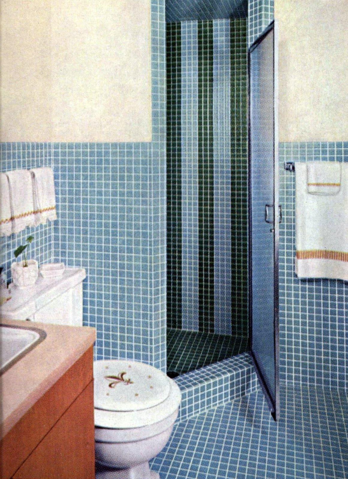 Vintage 60s light blue small square mosaic tile on bathroom walls, stall, floor