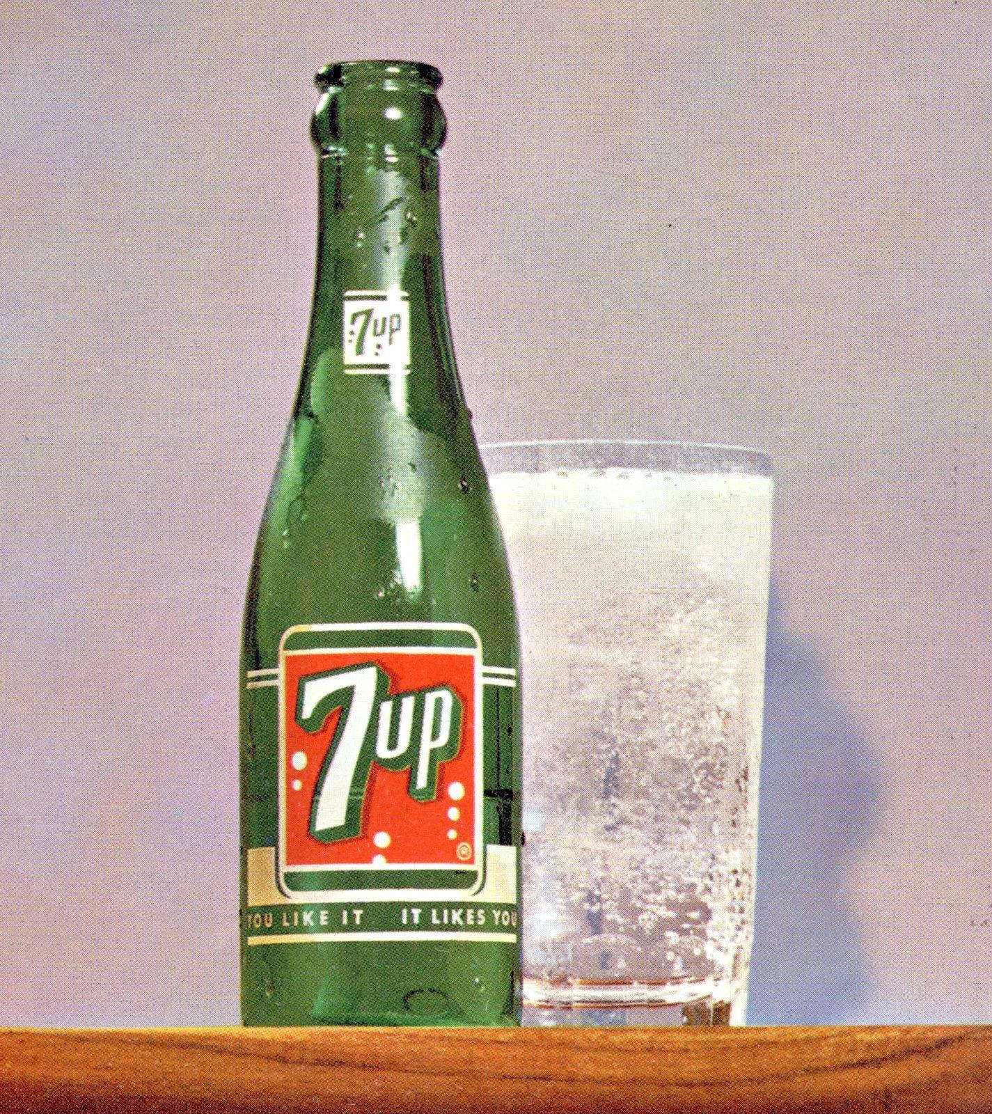 Vintage 7-Up soda bottle and glass of lemon-lime beverage