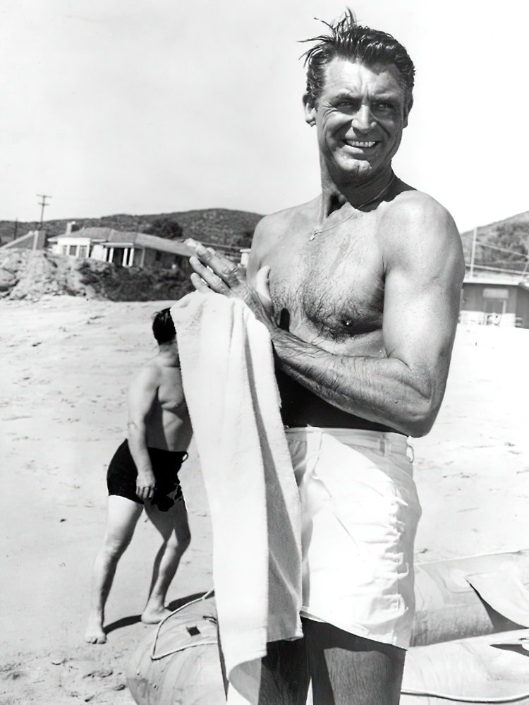 Vintage actor Cary Grant on the beach 1940s